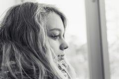 Monochrome profile portrait of blond teenage girl Stock Photo