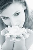 Monochrome rose petals #2. Monochrome picture of woman in spa smelling white rose petals stock images