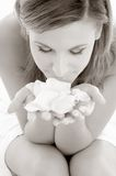 Monochrome rose petals. Monochrome picture of woman in spa smelling white rose petals stock image