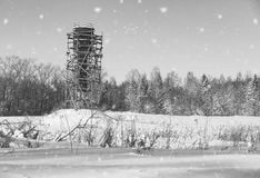 Monochrome scaffold around the water tower in field in front of Royalty Free Stock Image