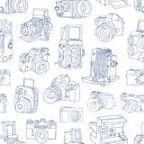 Monochrome seamless pattern with old and digital photo cameras hand drawn with blue contour lines on white background Royalty Free Stock Photography