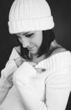 Monochrome shot of caucasian woman in white pullov Stock Photos