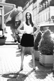 Monochrome shot of sexy slim woman in classic clothes on street Royalty Free Stock Photo