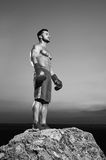 Monochrome shots of a fierce male boxer training outdoors Stock Photo