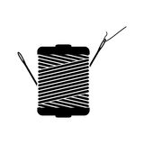 Monochrome silhouette with thread spool and sewing needle Royalty Free Stock Photo
