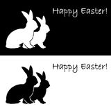 Monochrome silhouette of two Easter bunny rabbits. Stock Photography