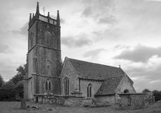 Monochrome St Michael and All Angels Church. St Michaels and All Angels 12th century parish Church in Kington St Michael Wiltshire England Royalty Free Stock Photos