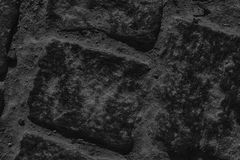 Monochrome Street pavement background, rock texture Royalty Free Stock Photography