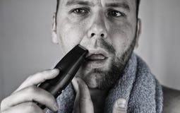 Monochrome textured portrait bearded man shaving Royalty Free Stock Photo