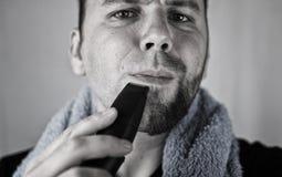 Monochrome textured portrait bearded man shaving Stock Image
