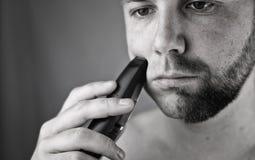 Monochrome textured portrait bearded man shaving Stock Photos