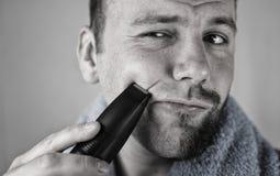 Monochrome textured portrait bearded man shaving Stock Images