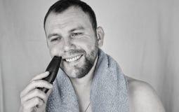 Monochrome textured portrait bearded man shaving Stock Photo