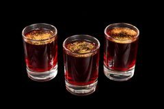 Summer cocktail on isolated black background. Monochrome transparent cocktails, a set of shots pile, wedge, three servings, with taste of berries, cherries Stock Images