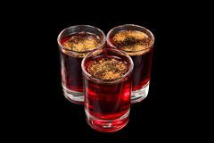 Summer cocktail on isolated black background. Monochrome transparent cocktails, a set of shots pile, wedge, three servings, with taste of berries, cherries Royalty Free Stock Photos