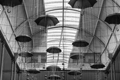 Monochrome umbrellas hang from the ceiling Royalty Free Stock Photo