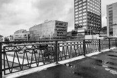 Monochrome urban landscape on rainy day. View on the business centres through the bridge Visokoyauzskiy, Moscow downtown, Russia. stock image