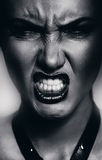 Monochrome very angry woman showing teeth Royalty Free Stock Photos