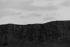 Monochrome view- Arthur`s Seat hills and two people, Edinburgh, Royalty Free Stock Photography