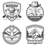 Monochrome Vintage Rodeo Emblems Set. With cowboy riding horse weapon skull bull head and horseshoe isolated vector illustration Stock Photography