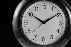 Monochrome Wall Clock on Black Background Royalty Free Stock Image