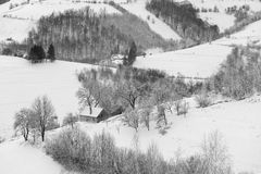 Monochrome winter landscape in Transylvania. Winter landscape of the transylvanian village and the houses  on a hill, in Holbav - Brasov, Romania Stock Image