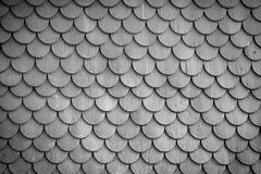 Monochrome wood tiling roof wall texture background. Old rustic wood tiling roof wall texture background. Traditional protection for roof and facade Royalty Free Stock Image