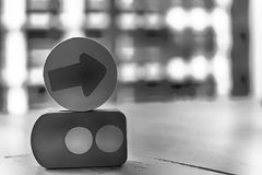 Monochrome Wooden toy arrow on the circle with traffic lights on the table.  Stock Photos