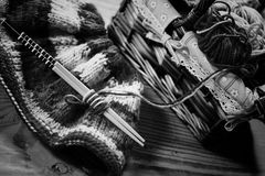 Monochrome wool and knitting needles Stock Photos