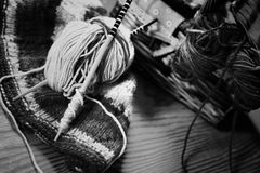 Monochrome wool and knitting needles Stock Images