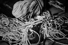 Monochrome wool and knitting needles Royalty Free Stock Image