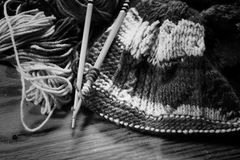 Monochrome wool and knitting needles Stock Image