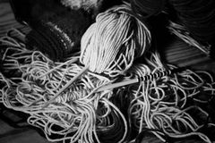 Monochrome wool and knitting needles Royalty Free Stock Photography