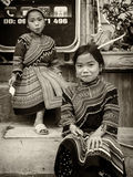 Monochrome - 2 Young minority tribe girls sit outside of mobile phone shop. Stock Images