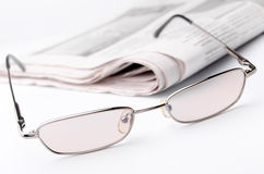 Monocolo e giornale Fotografia Stock