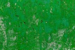 Monocolor green painted flat concrete surface closeup texture.  stock photo