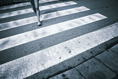Monocolor woman feet road crossing Royalty Free Stock Photos