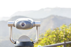 Monocular pointed at mountain landscape. Monocular pointed at a mountain landscape, shallow depth of field Royalty Free Stock Photography