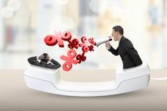 Monofone de telefone com o homem de negócios que grita em um outro homem Fotografia de Stock Royalty Free