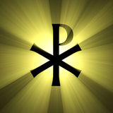 Monogram of Christ symbol light flare. Monogram of Christ (the Chrismon, the Labarum, Chi-Rho sign) with powerful sunlight halo. Extended flares for cropping Stock Image