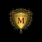 Monogram design elements, graceful template. Calligraphic elegant line art logo design. Gold letter M. Business sign for Royalty, Royalty Free Stock Image