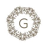 Monogram G logo and text badge emblem line art vector illustration luxury template flourishes calligraphic leaves Royalty Free Stock Images