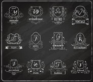 Monogram shields chalkboard set. Monogram shields chalkboard premium design set flat isolated vector illustration Stock Images