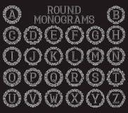 Monogrammes de vintage réglés dans les cadres floraux ronds Images libres de droits