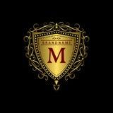 Monogrammgestaltungselemente, würdevolle Schablone Kalligraphische elegante Linie Kunstlogodesign Goldbuchstabe M Geschäftszeiche Lizenzfreies Stockbild