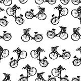 Monokrom sömlös fransk modell av cyklar med korgar Arkivbild