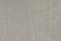 Monokrom textur av handarbete Härlig bakgrund med öglor Den stack produkten är ljus beiga royaltyfri bild