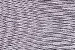 Monokrom textur av handarbete Härlig bakgrund med öglor Det stack plagget är den bleka lilan arkivbilder