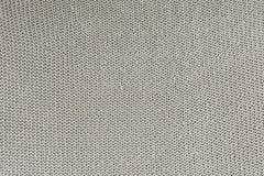 Monokrom textur av handarbete Tom bakgrund med öglor Den stack produkten är grå färg-beiga arkivfoto