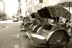monokromma trishaws Fotografering för Bildbyråer